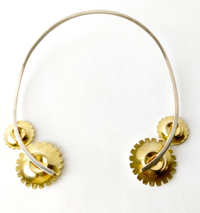 Sterling silver neckring with gilt sterling and enamel marguerite daisy necklace created by Bernhard Hertz of Denmark.  Neckring measures 15