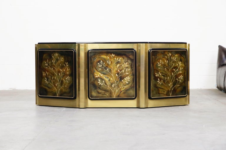 This incredible acid etched 'Tree of Life' brass cabinet was designed by Bernhard Rohne and produced by Mastercraft in the 1970s. Exquisite acid-etched artwork depicting three trees called 'The Tree of Life' take center stage on the three door