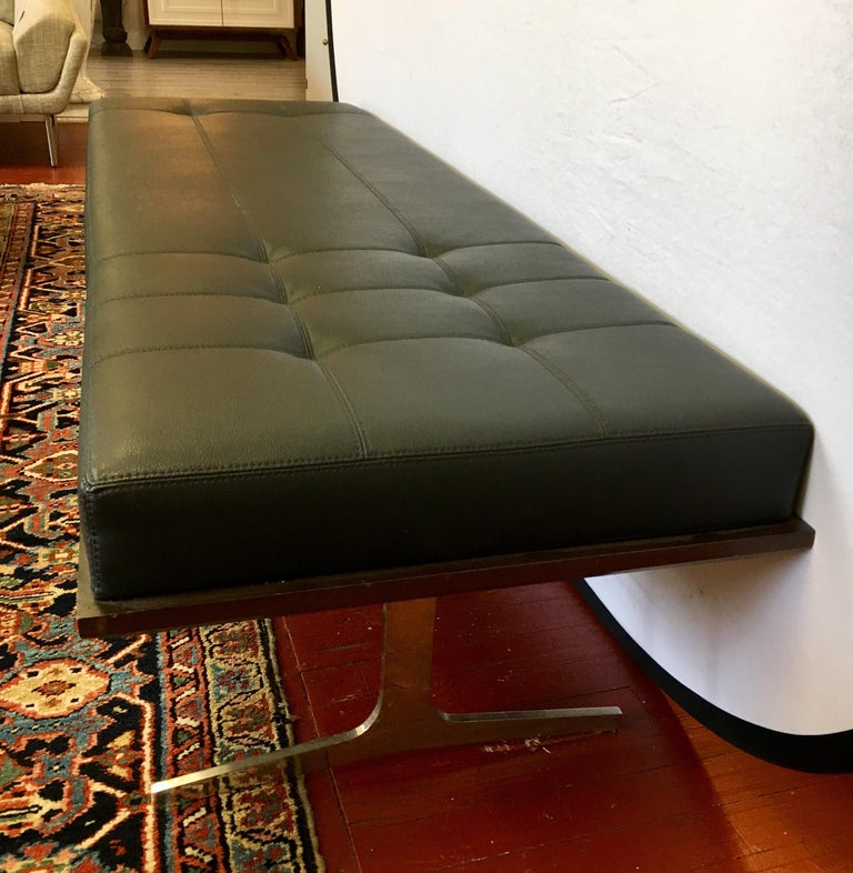 Elegant Berhardt black leather chaise lounge daybed with mahogany base and polished steel legs.