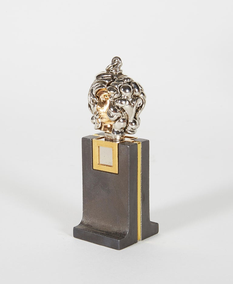 A small chrome plated brass pendant sculpture that comes apart in 23 pieces and locks into place. Comes with original box and pamphlet. The dimensions indicated are for the pendant only.