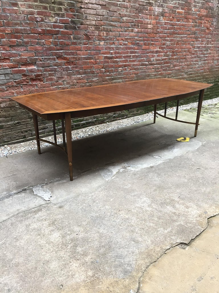 Bert England for Johnson Furniture Walnut and Brass Dining Table In Good Condition For Sale In Garnerville, NY