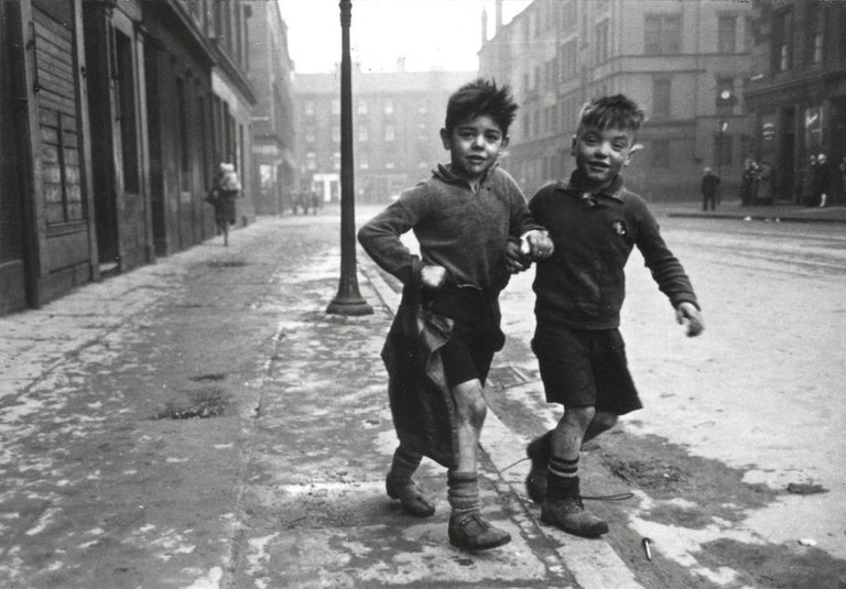 The Gorbals Boys, Glasgow - Bert Hardy (Black and White Photography) Signed on front, stamped with photographer's copyright ink stamp on reverse Silver gelatin print, printed later 12 x 16 inches  From the slums of London and Glasgow to the