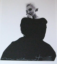 Marilyn in the black dress looking at you