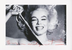 Marilyn Monroe  The last sitting Pearls 2 by Bert Stern .