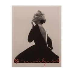 Marilyn Monroe in Black Dress Dior, 1962, by Bert Stern. Black & white portrait.