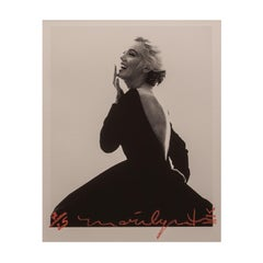 Marilyn Monroe in Black Dress Dior, 1962, by Bert Stern. Black & white portrait.