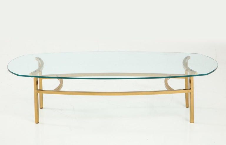 "Spare and architectonic brass cocktail table with gently sinuous curves and original glass top. A Bertha Schaefer design for M. Singer and Sons, circa 1954. Rare to the market. Documented in ""Modern Furnishings for the Home 2"" by William J."
