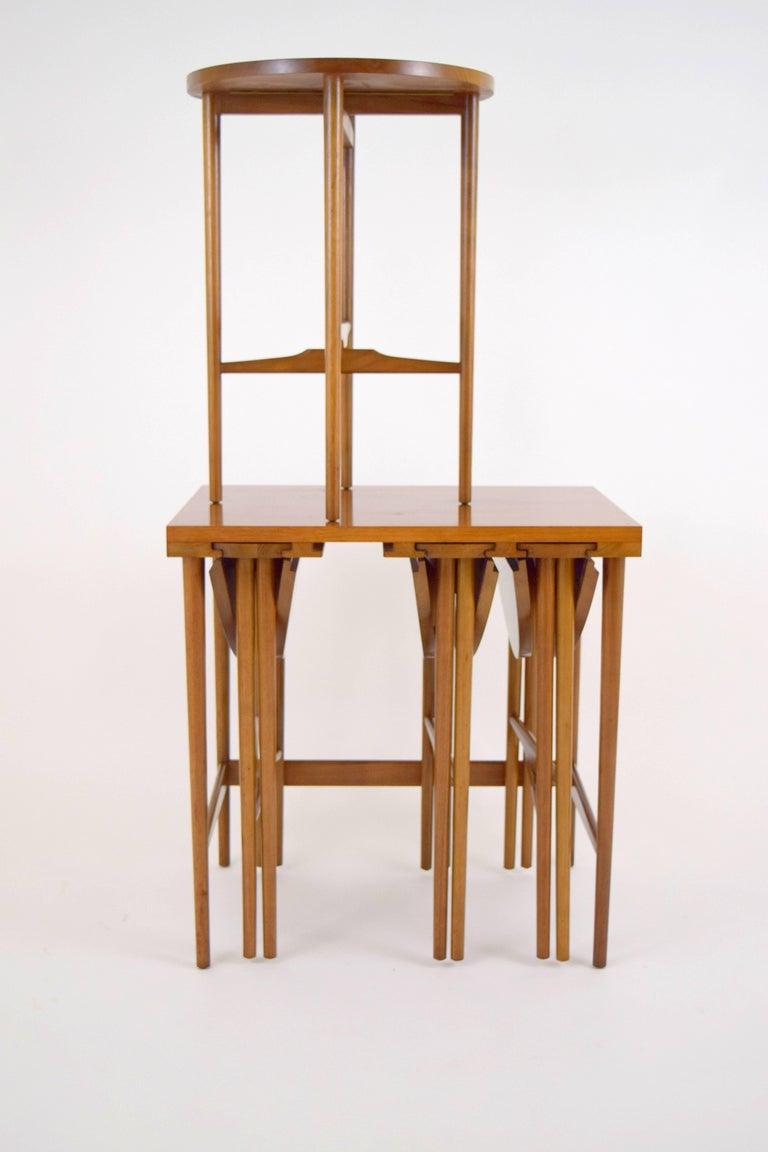 Classic Bertha Schaefer for M. Singer & Sons walnut nesting table set. Lovely walnut grain table with four 16.5
