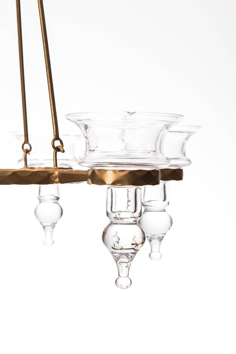 Chandelier / hanging candelabra designed by Bertil Vallien. Produced by Boda Smide in Sweden.