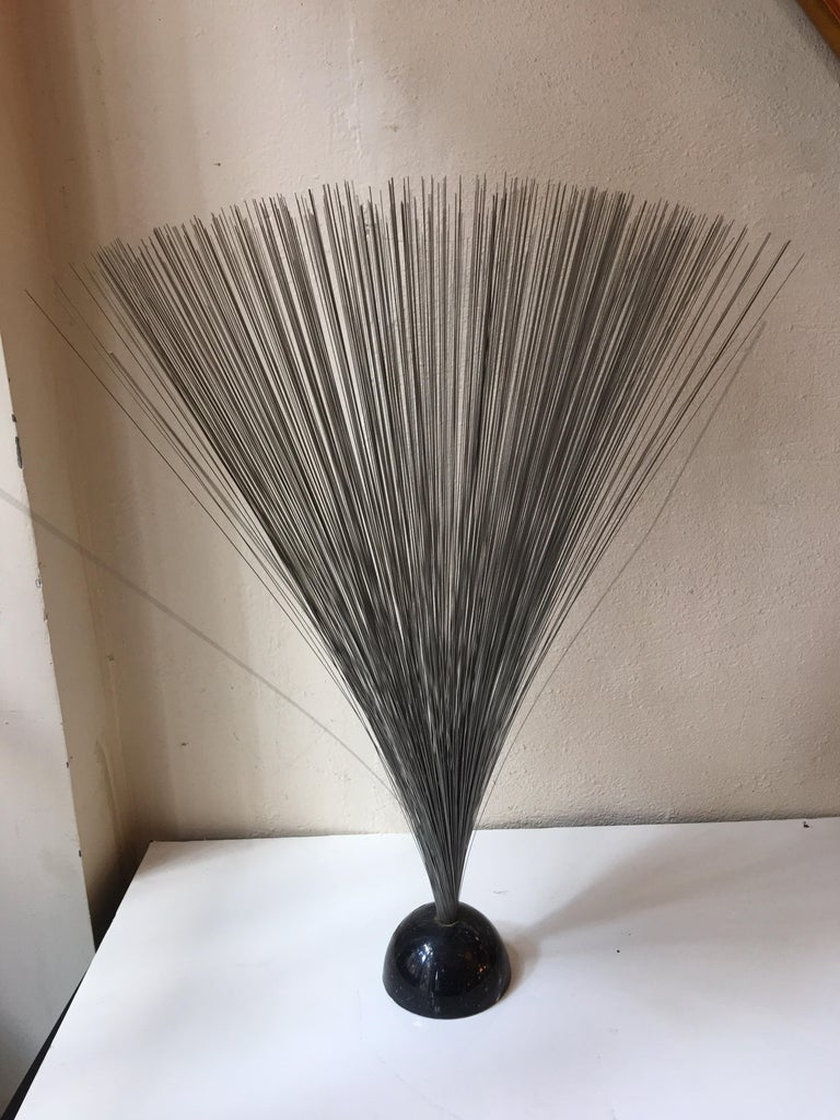 Nice Bertoia style sculpture with a 1/2 dome marble base. Probably from the early 1970s.