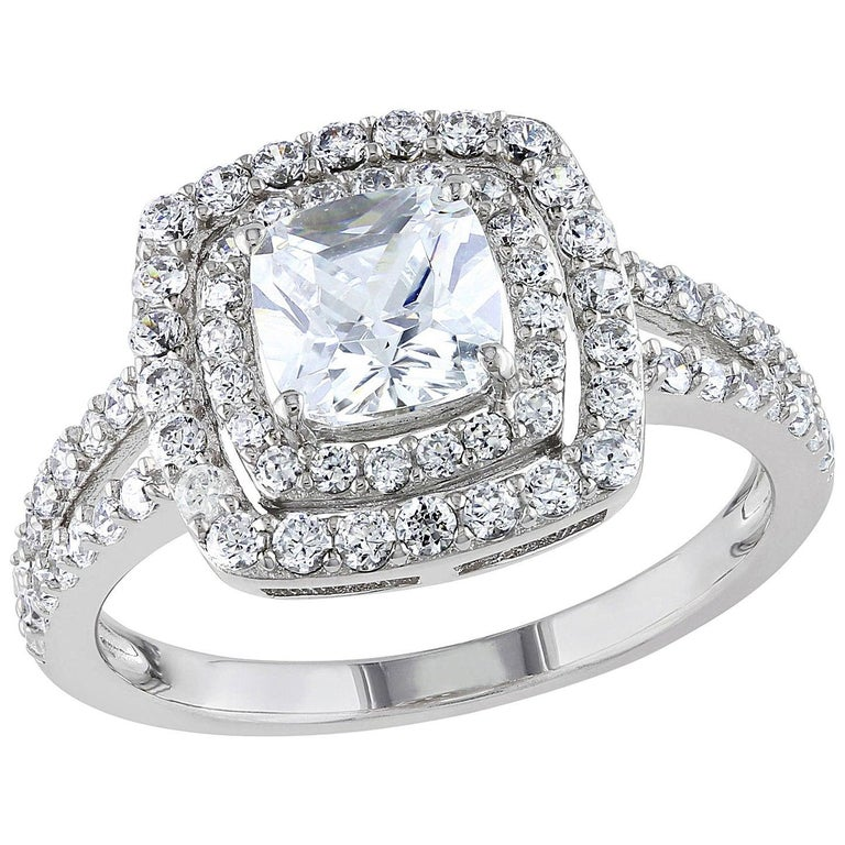 This is an image of a popular ring design, ideal for an asscher, princess or cushion cut diamond or coloured gem centre stone.  The double halo and split shank contains between 0.75 and 1.25 carats of diamond points. We would recommend a centre