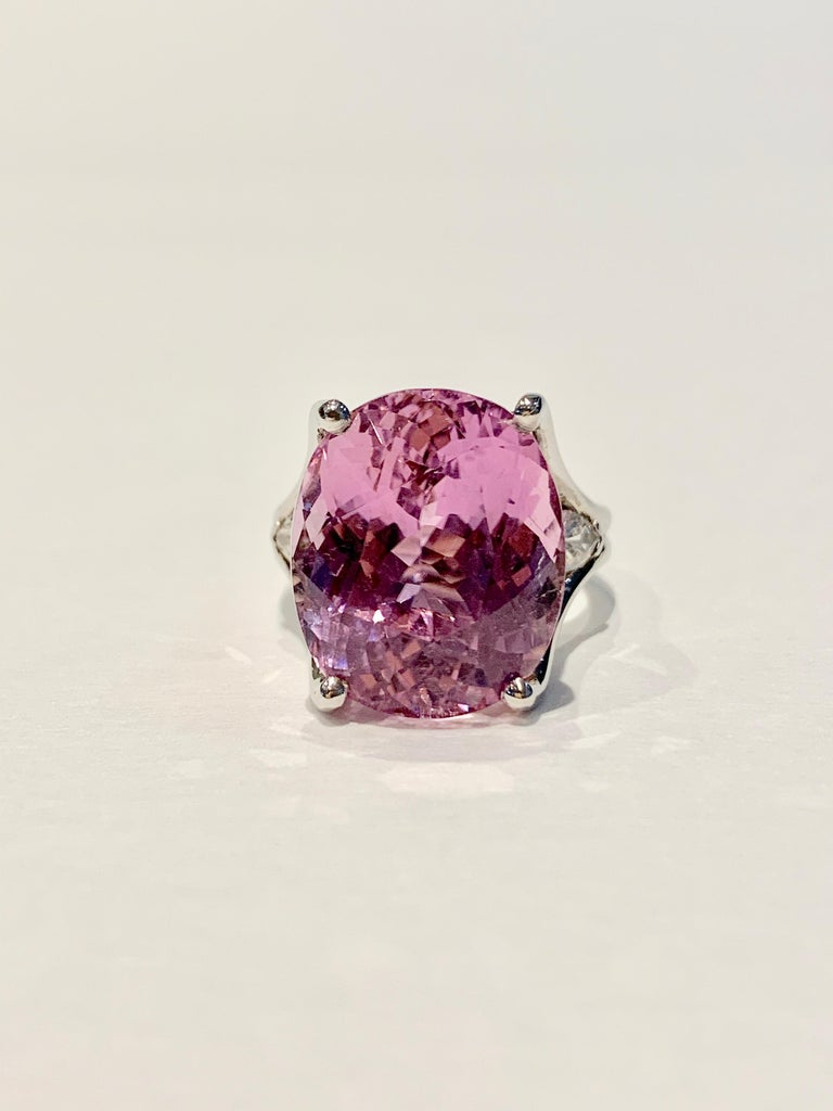 This BESPOKE designed Cocktail ring is set with an eye catching and incredibly feminine strong pink Kunzite* stone weighing 18cts and measuring 17 x 14 mm.  A CAD was used to get this modern double band design and to show off the Kunzite at its