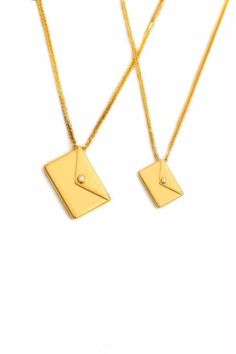 This enchanting pendant necklace has been crafted to the finest detail. A single envelope hangs on a rich gold chain, with a single diamond luring you in for closer inspection. From here you are able to open the envelope and retrieve a letter which