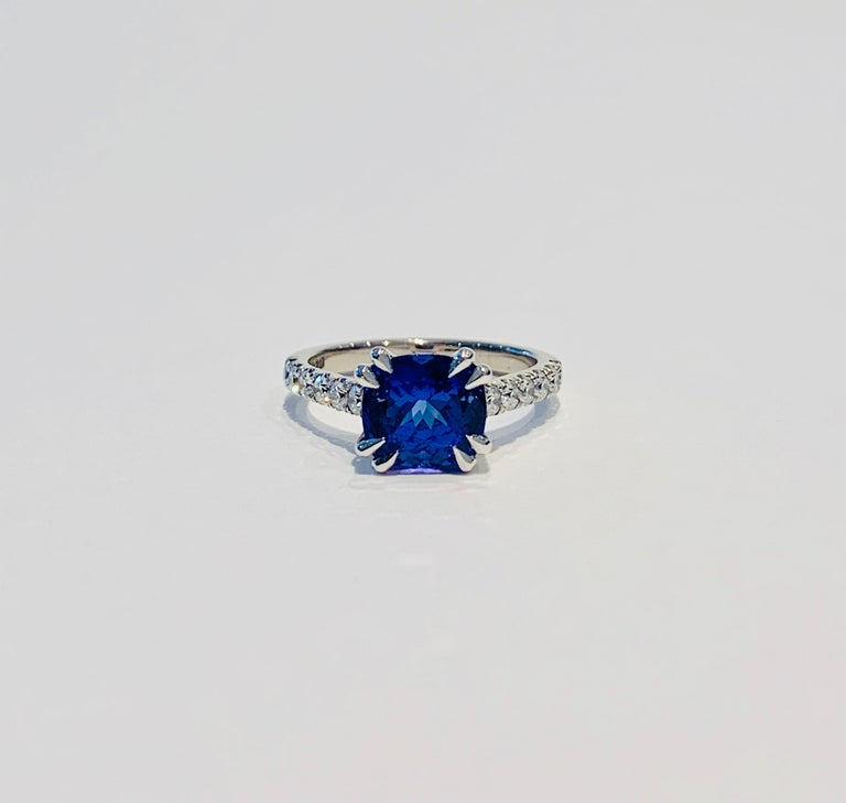 This premium stone is Tanzanite* at its best!  The velvety rich deep blue shows a little violet and has wonderful clarity.  A CAD was used to show this 7x 7 mm cushion cut Tanzanite at it best and the double claw setting gives it a very modern