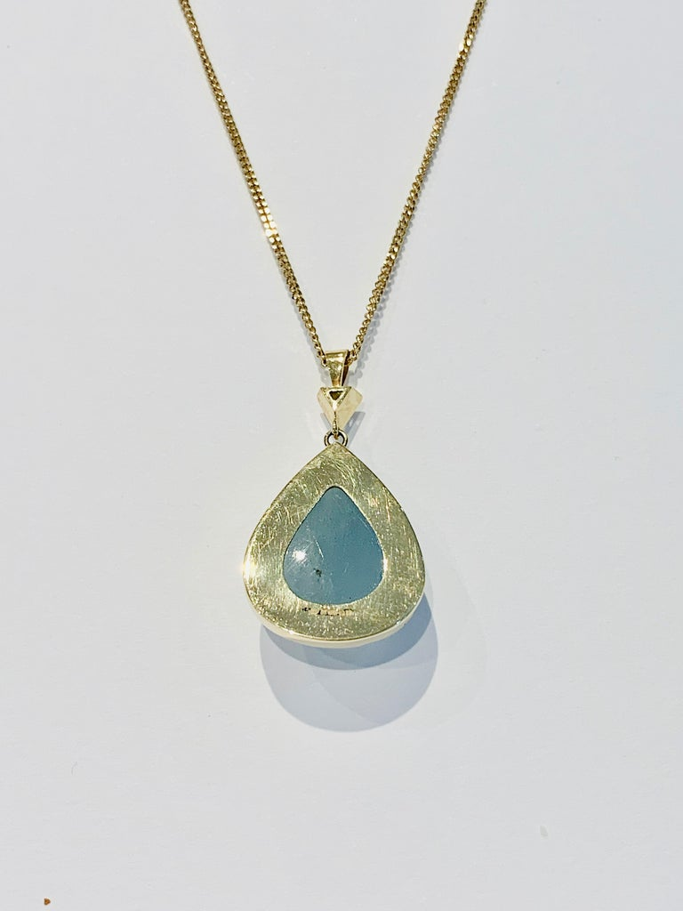 This unique BESPOKE Pear Cut Cabochon* Aquamarine* Pendant was designed using a CAD to make sure this large stone was shown off to its best,, also making this Pendant unique.  The design is of a bezel setting made of 18ct Yellow Gold and has a .20ct