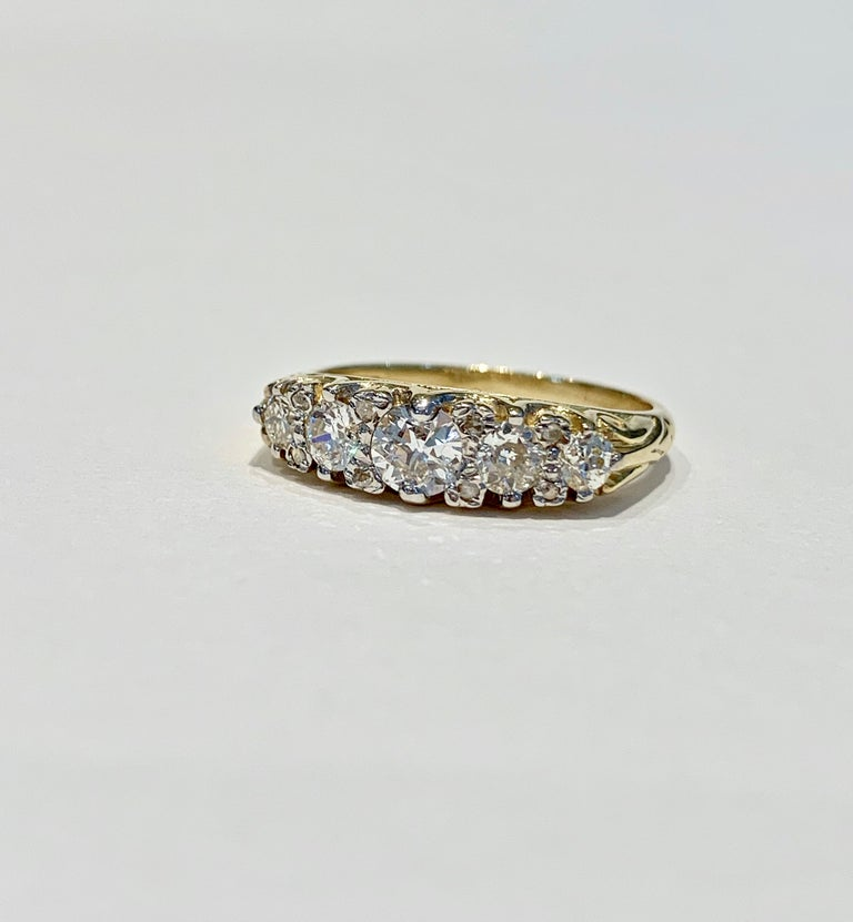 This Bespoke 5 stone ring is set with graduating round Old Cut* diamonds, approximately 1.30 ct. in total.   The scintillation and rainbow colours coming from all the diamonds is stunning.   The ring has recently been handmade with scroll work on