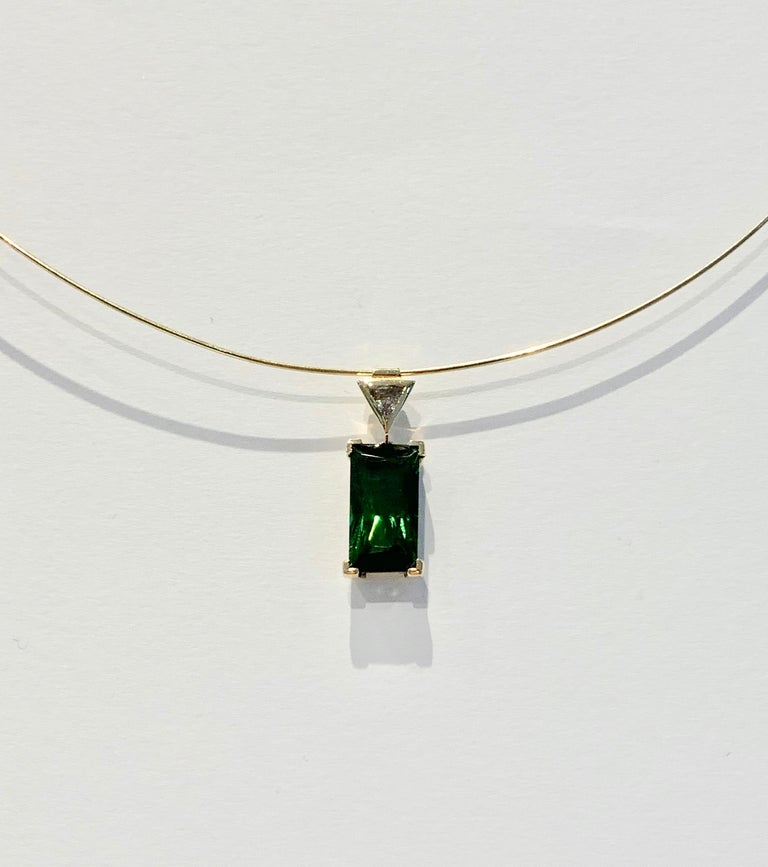 Stunning and eye catching, this gorgeous Bespoke 6.10ct Green Tourmaline* is set in a contemporary design Pendant.  The stone measures 15.6 x 8.7 mm, has a deep bright green colour and amazing clarity.  A CAD was used to make sure the Tourmaline was