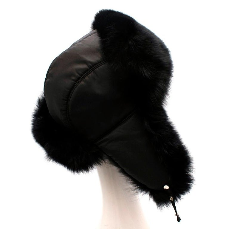 Bespoke Black Nylon & Vison Fur Padded Hat   -Luxurious soft vison fur  -Smooth nylon   -Pressure button fastening that can be tied to the chin or to the head   -Fur ear covers  -Fully lined  -Perfect for some winter street style
