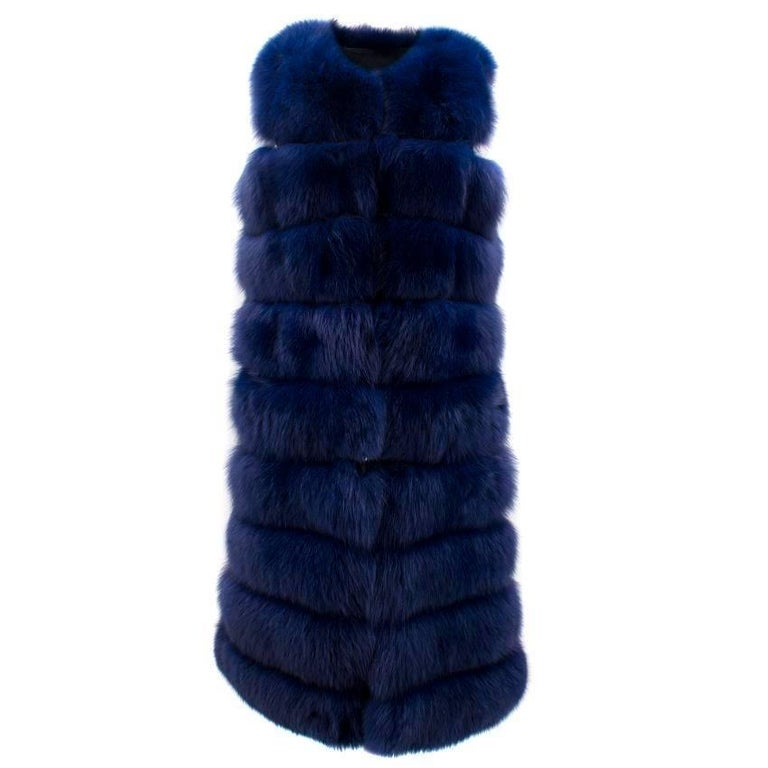 Bespoke blue fur vest- coat.   Vest- coat. Features hook and eye fastening.  Features removable zip halfway through the coat to adjust length.   Perfect condition: 10/10. Never worn without tags.   Fabric: Fur/Silk/Suede lining.   Size: S/Small.