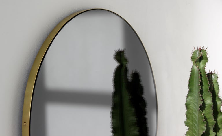 Orbis™ Black Tinted Round Contemporary Mirror with Brass Frame - Large For Sale 1