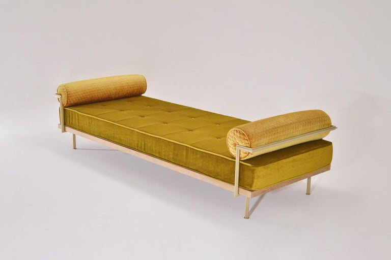 We created this double daybed for our Aurele 'LostDog' exhibit to go with the gold dog sculptures the artist created for the Bangkok Biennale.   While we can upholster with any fabric you send our way, we still love the wide range Jim Thompson