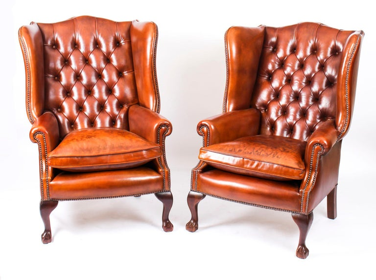 This is an absolutely stunning bespoke new leather suite comprising a 'Club Settee' with a pair of Wingback armchairs all in a beautiful antiqued Bruciato colour, hand-made in England with materials of the finest quality.  It all features fantastic