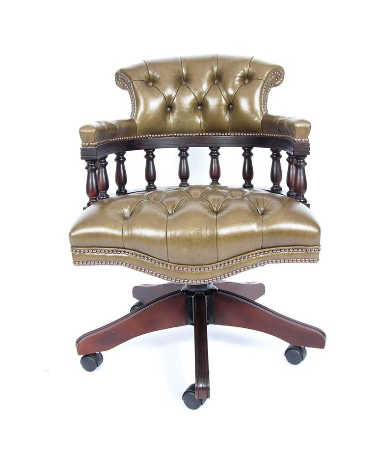 This is an absolutely superb bespoke new leather 'Captains chair' in a beautiful antique Olive green colour, hand-made in England with materials of the finest quality.
