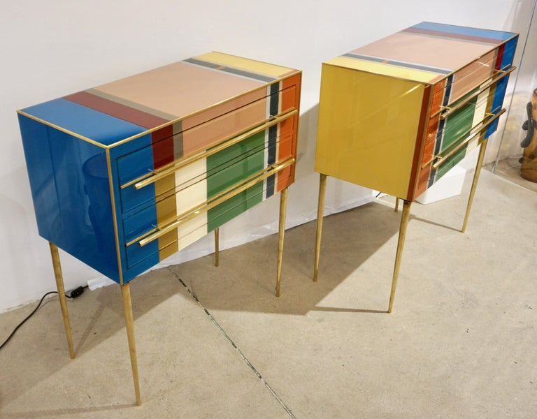 Contemporary customizable modern graphic pair of recycled geometric Pop design two-drawer bedside tables / nightstands, entirely handcrafted from reclaimed wood with a Piet Mondrian inspired abstract decor, the surrounds edged in brass are in