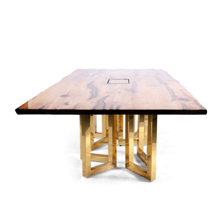 An eye-catching interplay of shapes and proportions, this table encompasses fine craftsmanship and an innovative design that will enhance any modern meeting room or dining room. This luxurious office table is handmade from old, reclaimed oak with