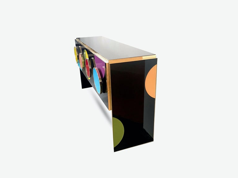 Bespoke sideboard  Colored glass  Four doors  Brass inlay  Contemporary, Italy.