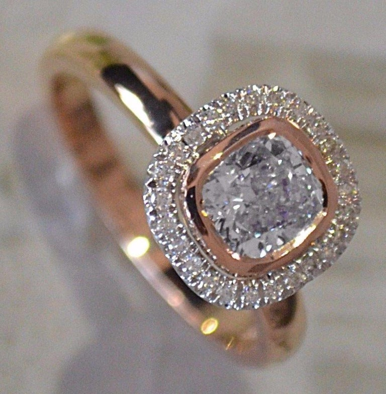 Round Cut Best Ring, 1 Carat Center Round with Diamond Halo Set in 18 Karat Rose Gold For Sale