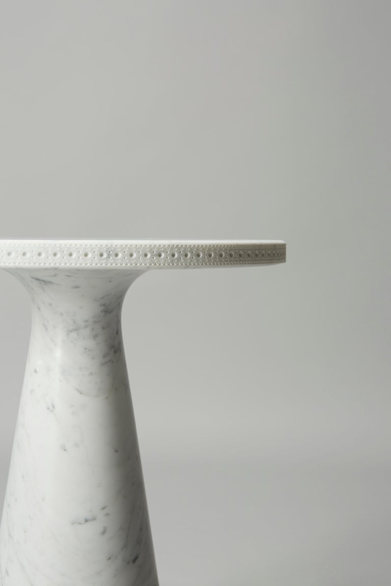 The all marble Brogue table is a variation on one of Bethan's hallmark creations. Here the design is translated into solid Carrara marble and includes the complex brogueing detail precisely carved by state of the art machinery, then hand finished by