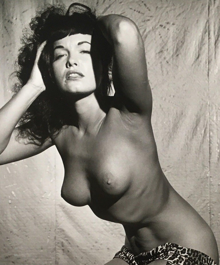 Bettie Page Topless in Studio 1954, by Bunny Yeager Gelatin Silver Print Image size: 20 in. H x 24 in. W Frame size: 32 in. H x 26.5 in. W Edition #2/5 Signature label Accompanied by certificate of authenticity from Bunny Yeager