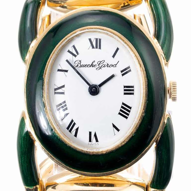 Vintage 1960's Equestrian theme 18k yellow gold green enamel wristwatch. 17 jewel manual wind movement. All original. Length 7.5 inches  Length: 42.24m Width: 28.84mm Band width at case: 18mm Case thickness: 6.31mm Band: 18k Gold Crystal: