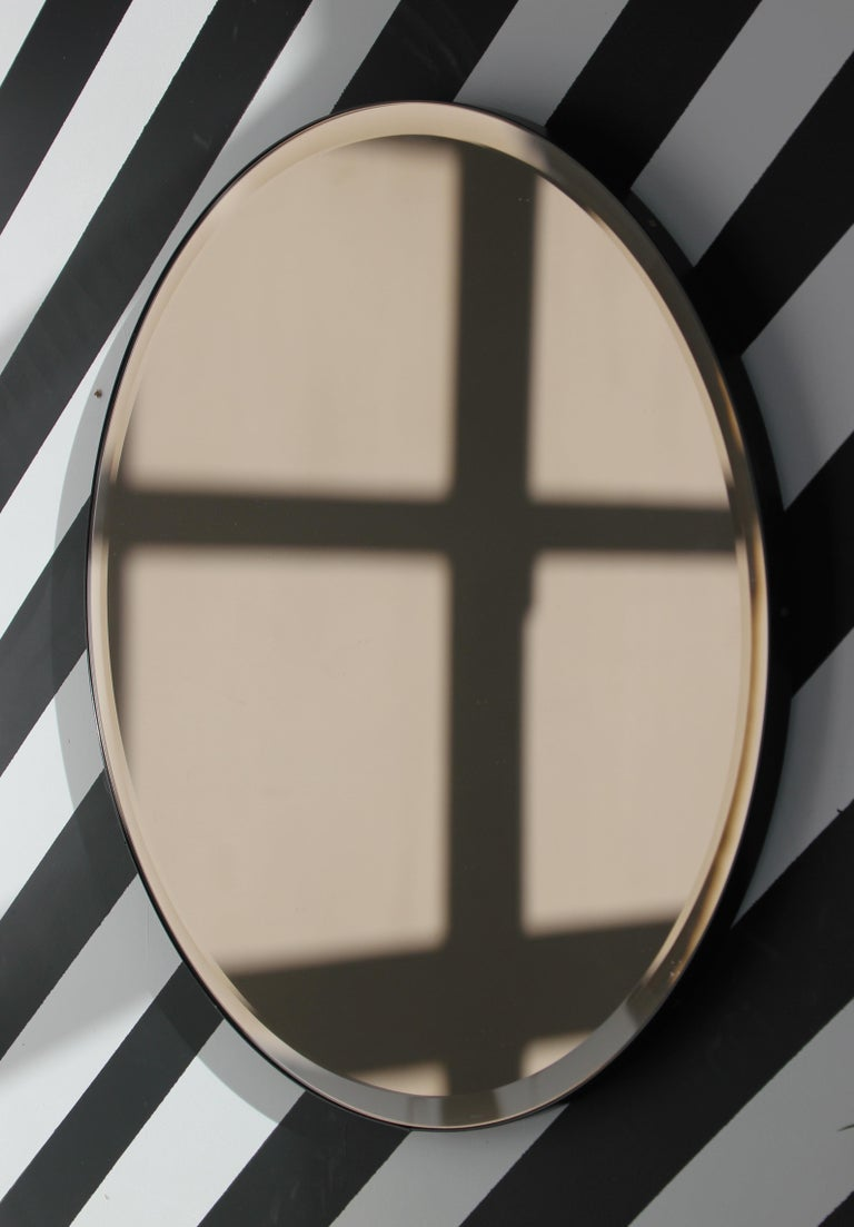 Aluminum Orbis™  Beveled Bronze Tinted Round Elegant Mirror with a Black Frame - Large For Sale