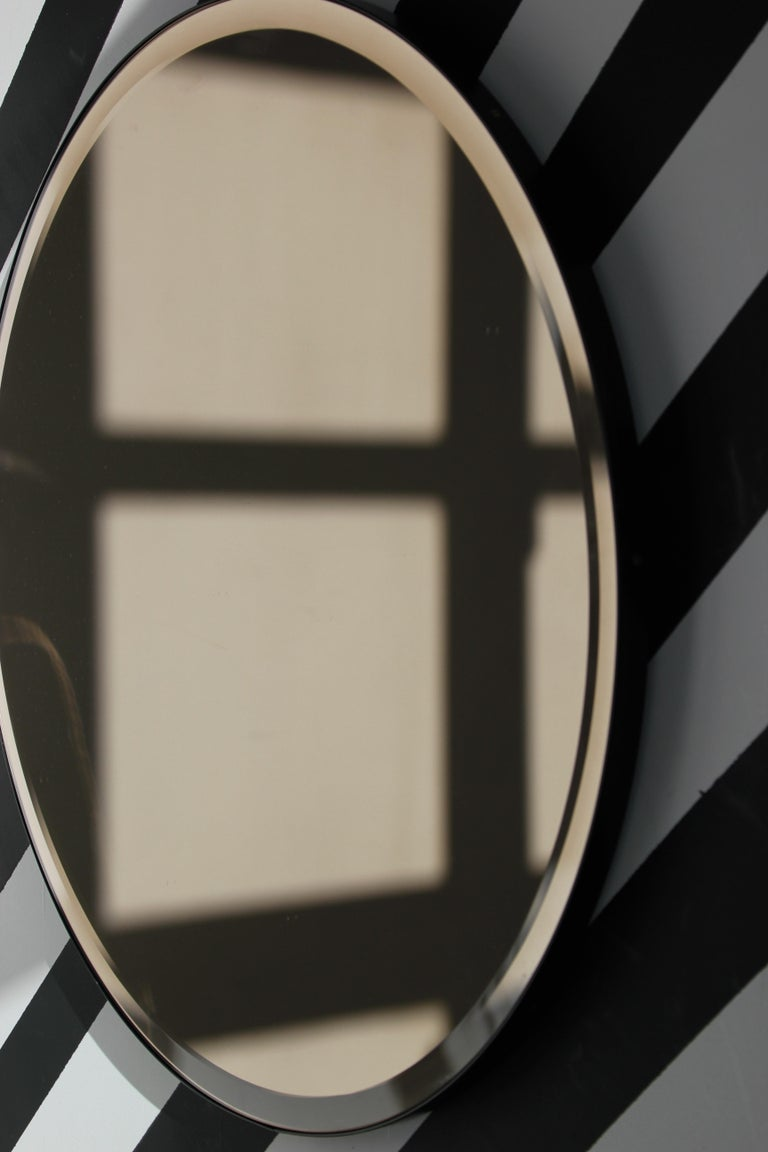British Bevelled Bronze Tinted Orbis™  Round Mirror with a Black Frame For Sale