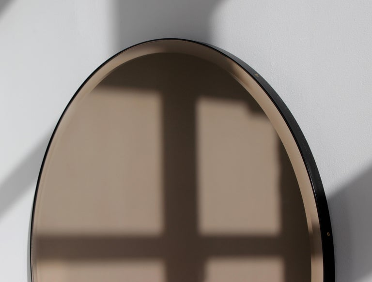 Powder-Coated Bevelled Bronze Tinted Orbis™  Round Mirror with a Black Frame For Sale