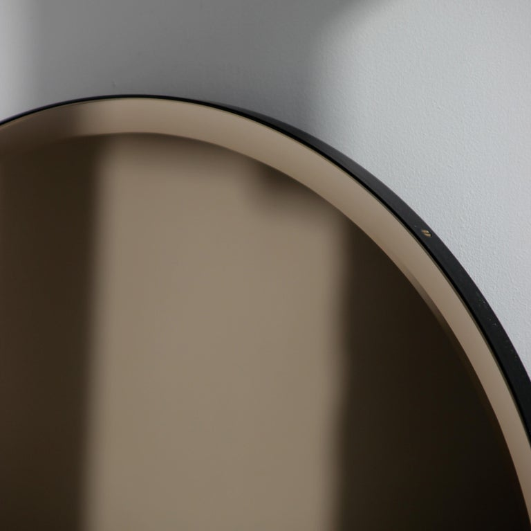 Contemporary Bevelled Bronze Tinted Orbis™  Round Mirror with a Black Frame For Sale