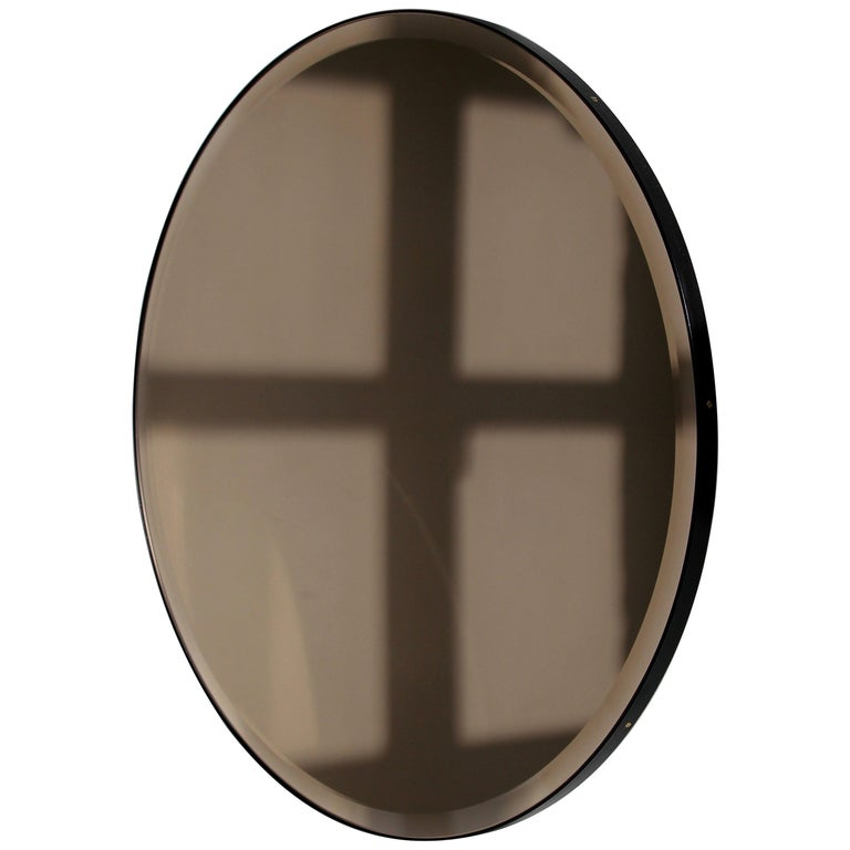 Bevelled Bronze Tinted Orbis™  Round Mirror with a Black Frame For Sale