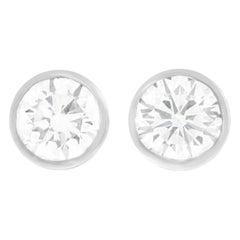 Bezel-Set Diamond Studs Platinum, circa 1990s, American