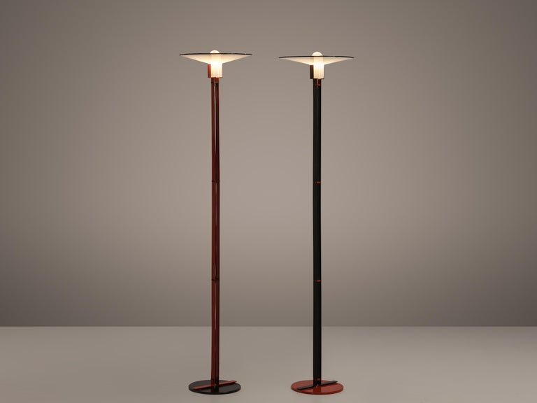 VeArt, pair of floor lamps, metal, glass, Italy, 1970s  This pair of elegant floor lamps by Italian manufacturer VeArt shows lovely details. From a round base two flat stems rise upwards, holding the cable in their middle. On top rests the shade