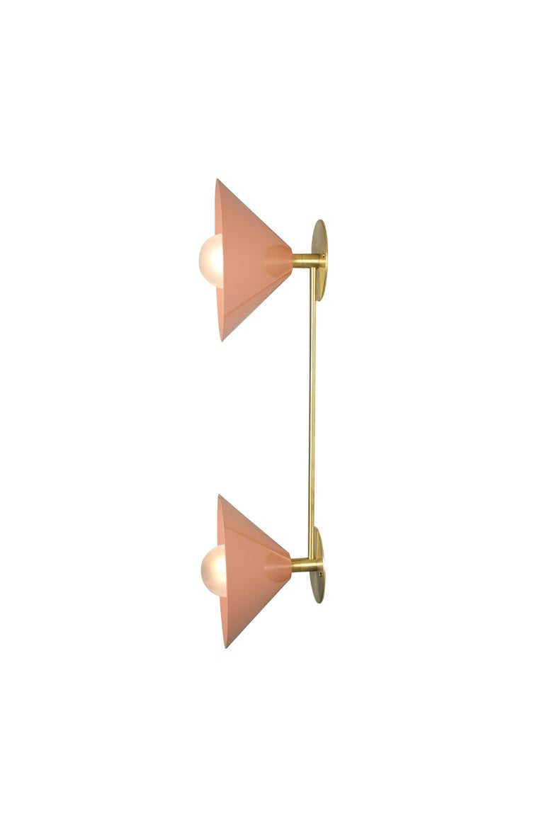 The bi-focal wall lamp conveys a strong modern design defined by balance and symmetry. The Focus family of products, designed in 2019 by Blueprint Lighting, features clean, handsome lines that work well in modern or traditional interiors.  The