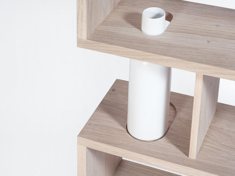 The Bibliofleur, marriage of solid oak and ceramic, highlights artefacts, books and… flowers. The vases can be easily handle to change the water. A groove in between each shelf enables to put an additional vertical partition.  100% solid oak from