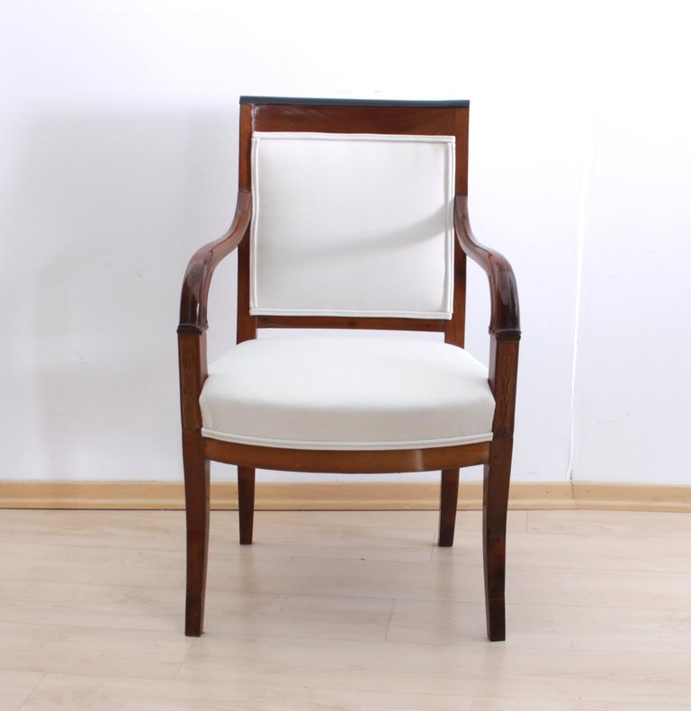 Comfortable and elegant early Biedermeier armchair from France. 