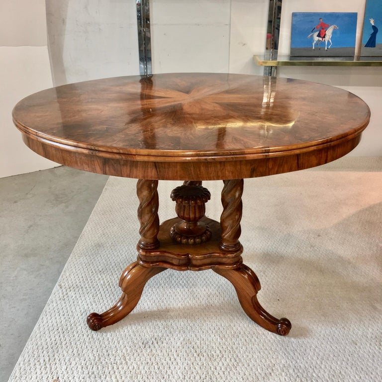 Biedermeier pie figured walnut veneer center table with reed moulded edge on twist turned legs on a moulded plinth base with fluted vase finial on scrolled legs. Beautifully restored. Ready to place.