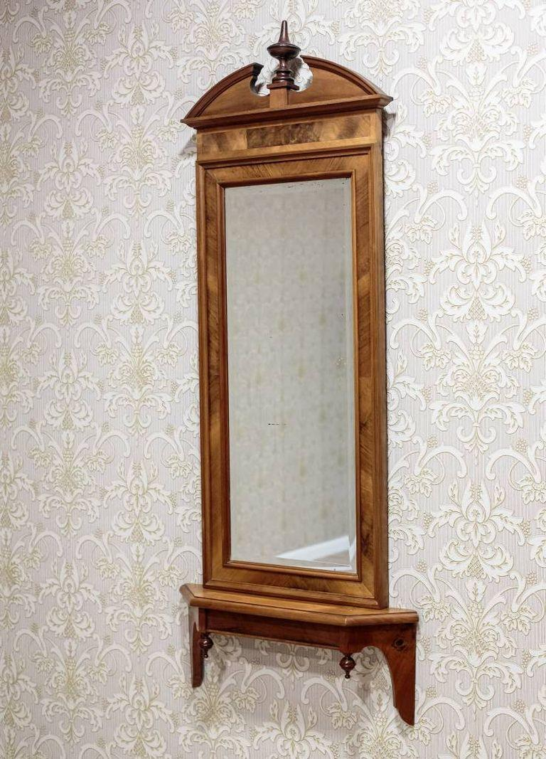 An interesting Biedermeier mirror, circa 1880, in a wooden frame of mahogany veneer.