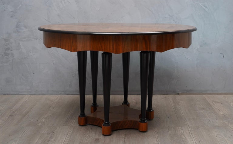 Extremely rare Biedermeier extendable table, all attention is focused on the beautiful patina of the walnut wood and the excellent craftsmanship. Note the band below on the table with its particular processing. Very very elegant.  The table is all