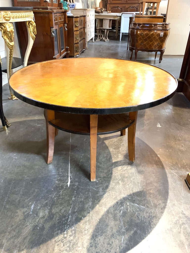 Beautiful midcentury Biedermeier fruitwood ebonized cocktail table with a lower shelf. A very fine table that mixes well with a variety of decors.