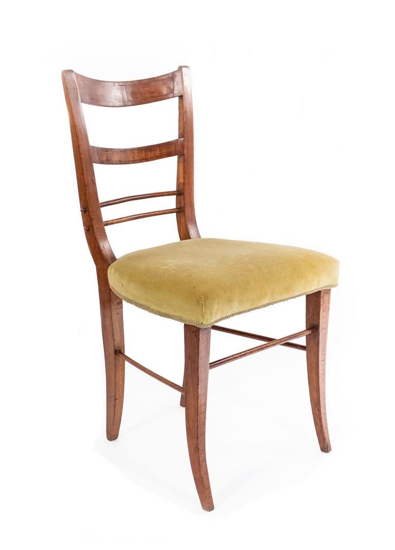 Pair of Biedermeier ladder back side chairs with light green velvet upholstered seats.