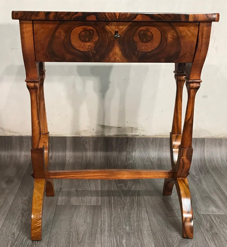 Unique and original Biedermeier sewing or side table, which dates back to circa 1820 and originates in Austria. The table has one-drawer, inside it are different compartments for sewing utensils. The base of the table is beautifully designed.